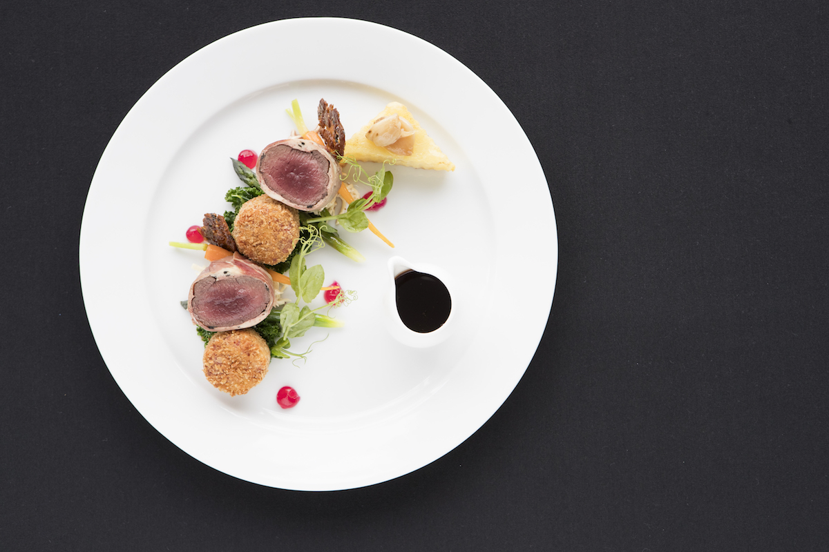 Amayjen - The Restaurant dish: Silver Fern Farms venison tenderloin encased in a truffle and trumpet mousse, with beetroot, Silver Fern Farms Shank risotto cake, cranberry gel, celeriac remoulade, fondant pot, shallot, kale, seasonal vegetables and a port wine and beetroot jus.