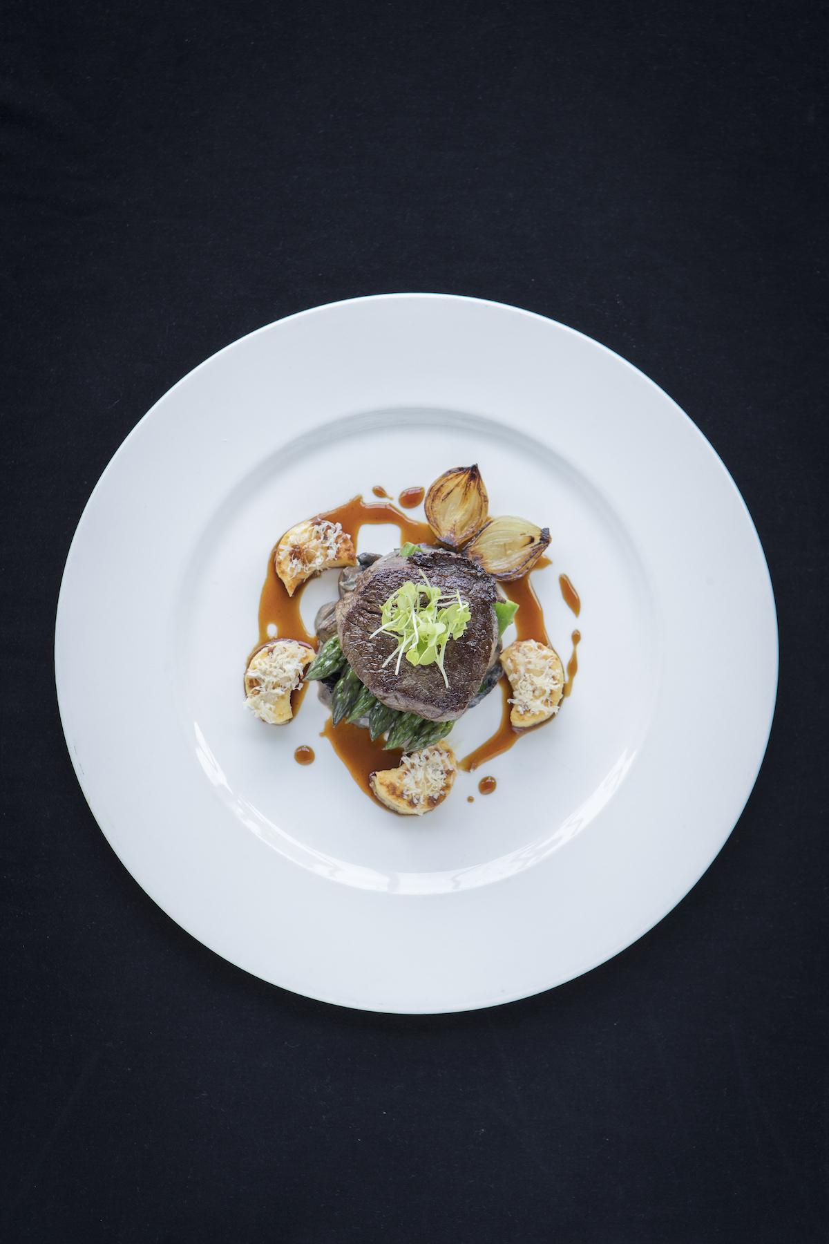 Chameleon Restaurant at the Intercontinental Wellington dish: Silver Fern Farms beef tenderloin, mushroom ragout, roast Parmesan gnocchi, button onion and asparagus.