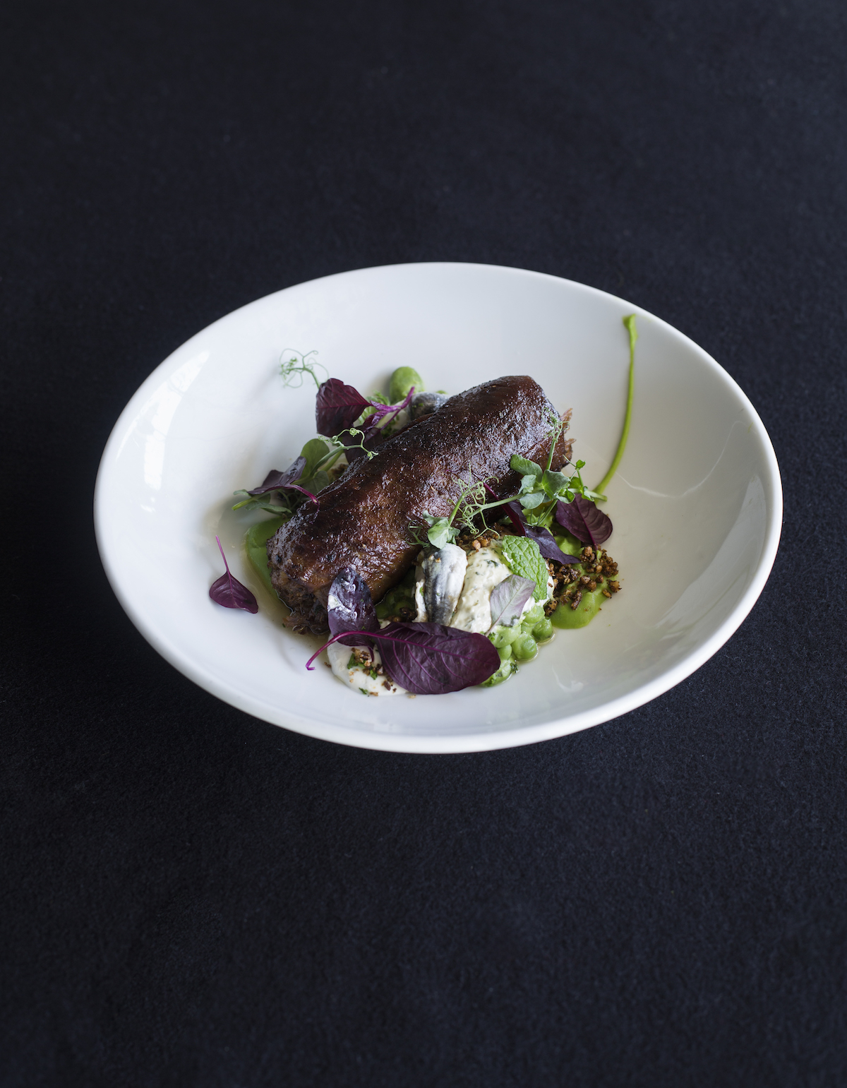 Molten Wine Bar dish: Wood fire-grilled Silver Fern Farms rolled lamb belly salad of pea, broad bean, goats cheese with anchovy butter.