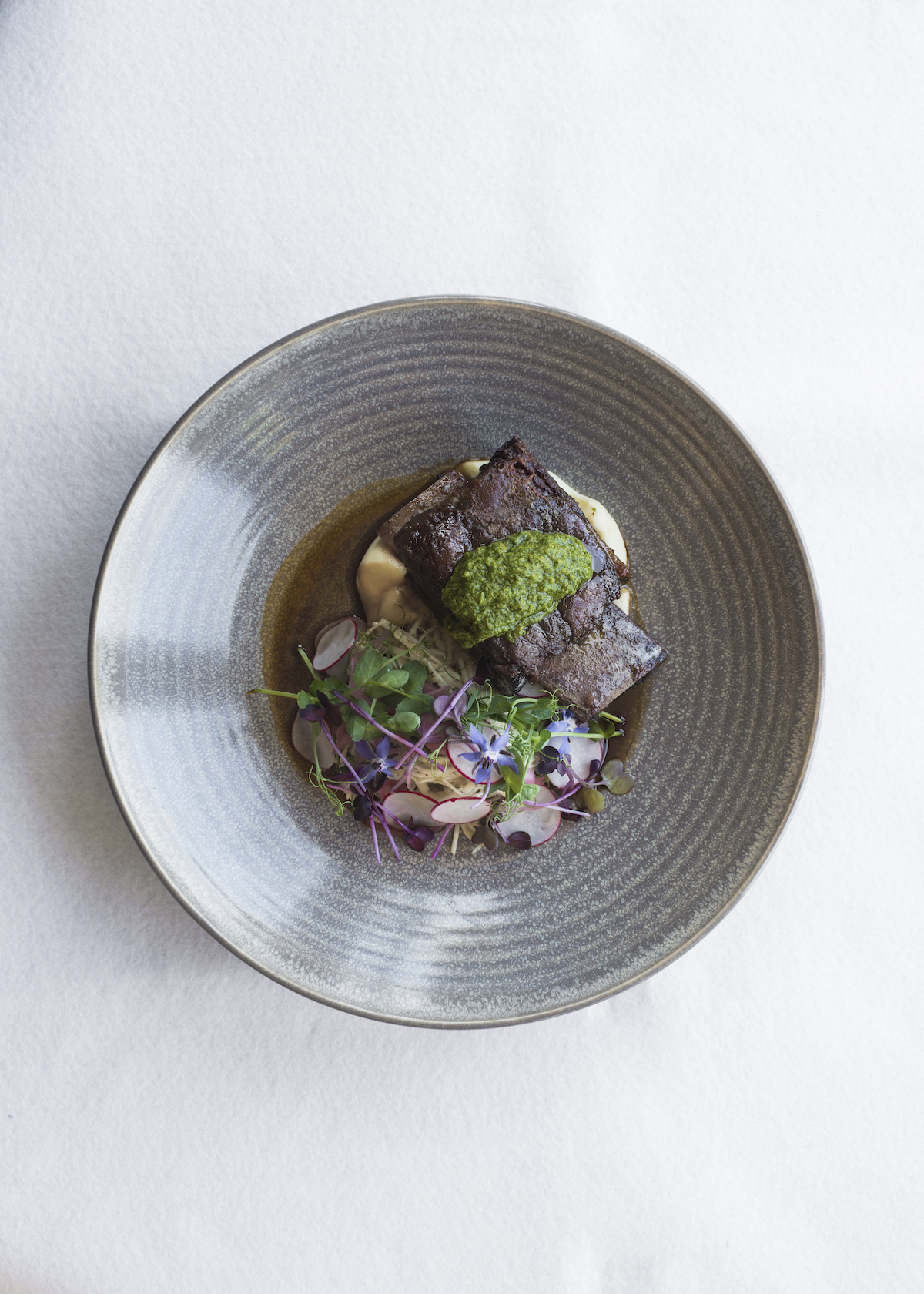 Archive Bar and Bistro, Mudbrick dish: Slow cooked Silver Fern Farms beef short rib with celeriac and fennel remoulade, radish and garden herbs.