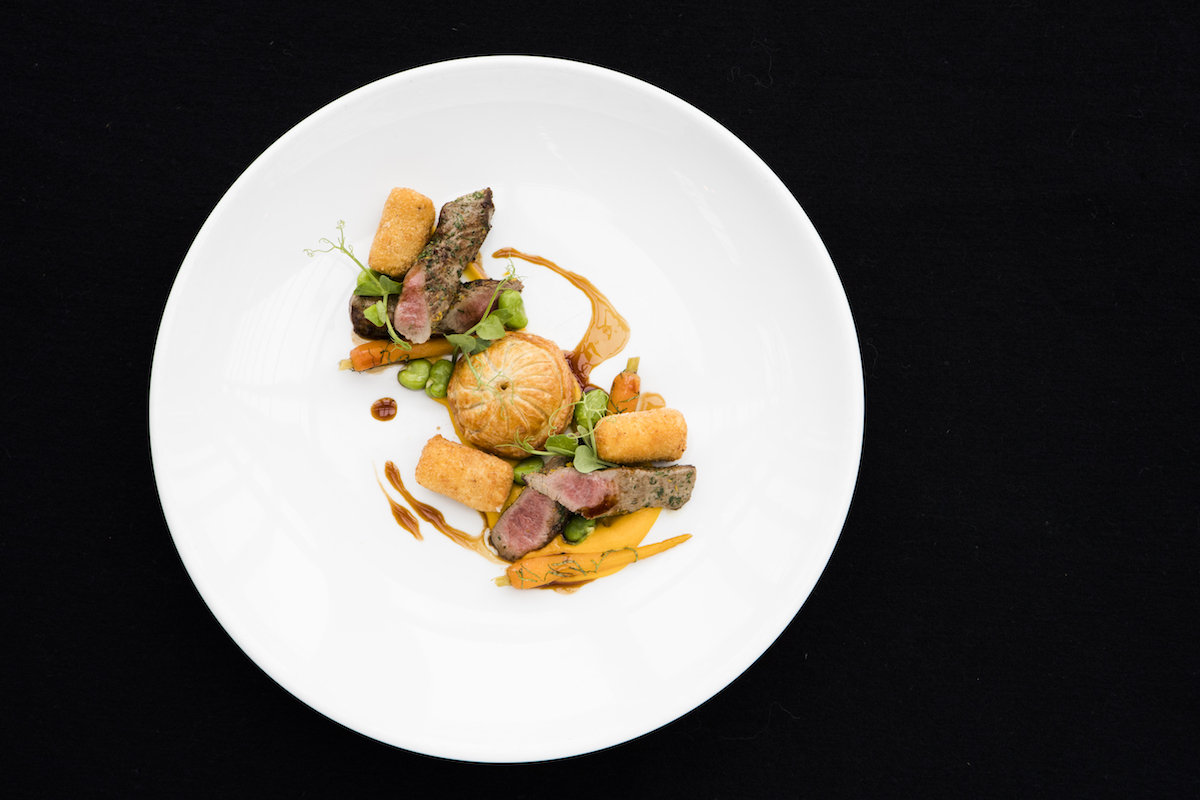 Shed 5 dish: Cumin gremolata Silver Fern Farms lamb fillet, lamb neck and swede pithivier, honey and mint carrot, broad beans, chevre croquette, braising liquor.