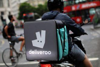 A deliveroo rider prepares to enter traffic