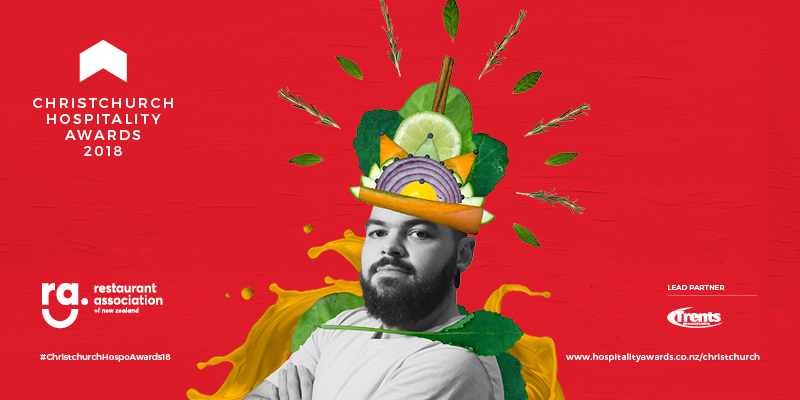 A banner advertising the Christchurch Hospitality Awards featuring a man in an outfit made from fruit