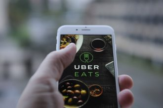 The Uber Eats app opening screen is seen on an iPhone