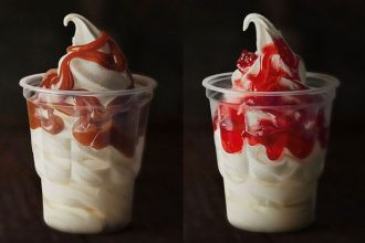 A caramel and strawberry McDonald's sundae sit side by side on a black background