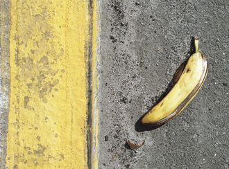 Banana peel on sidewalk