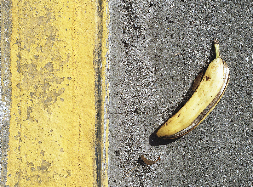 Banana peel on sidewalk