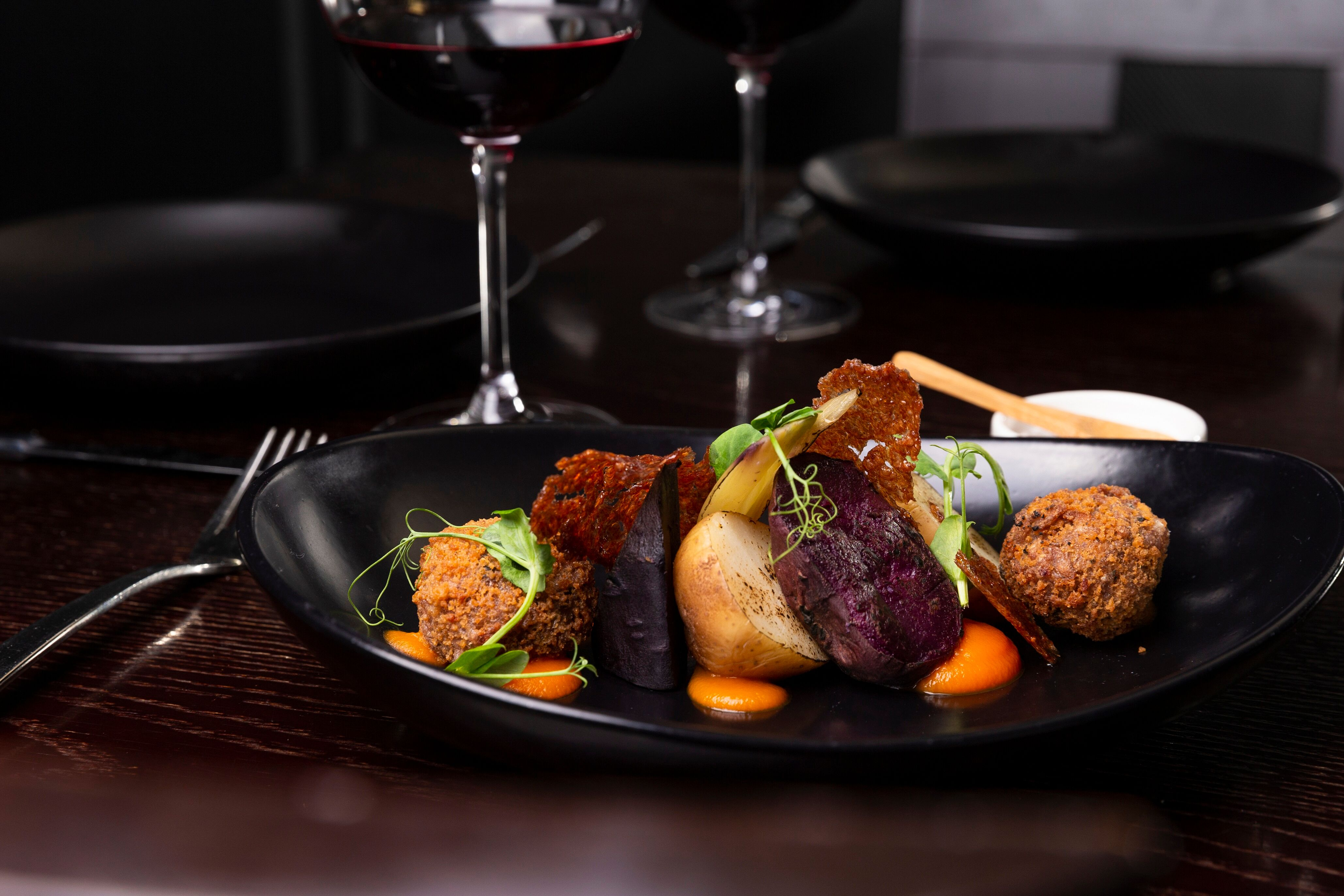 Hāngī style vegetables, carrot puree and horopito arancini.