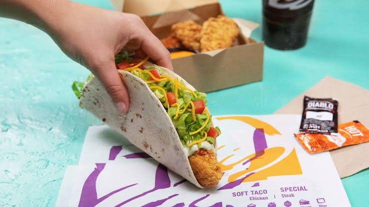 Taco Bell Crispy Tortilla Chicken held by hand