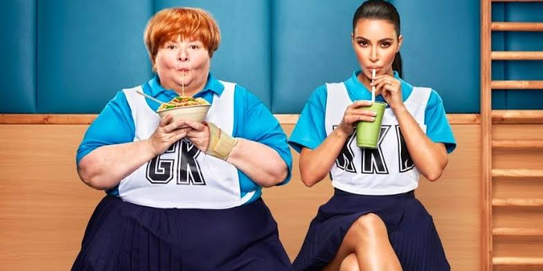 Sharon sitting next to kim while sipping on straws
