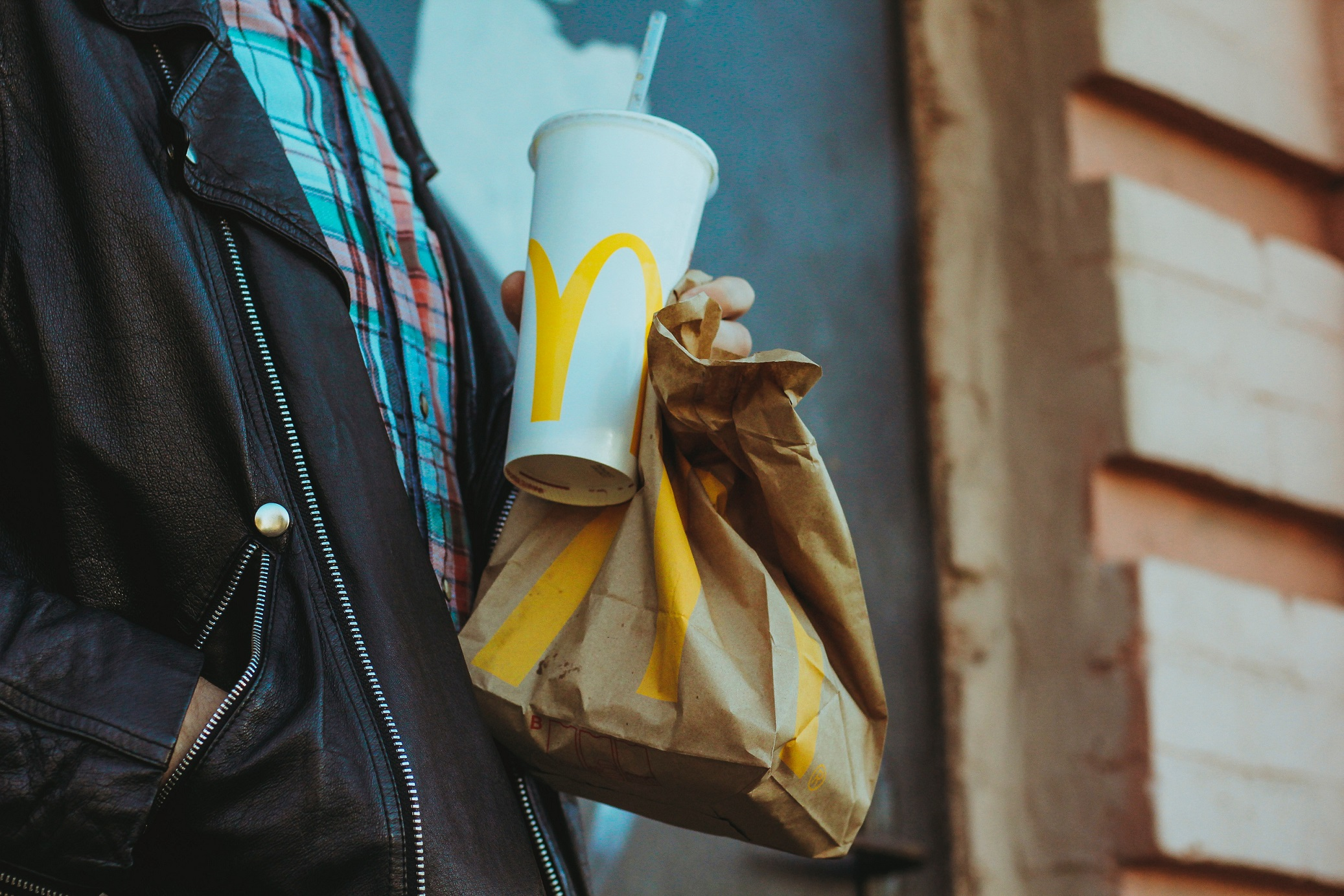 Guy holding McDonald's bag and cup