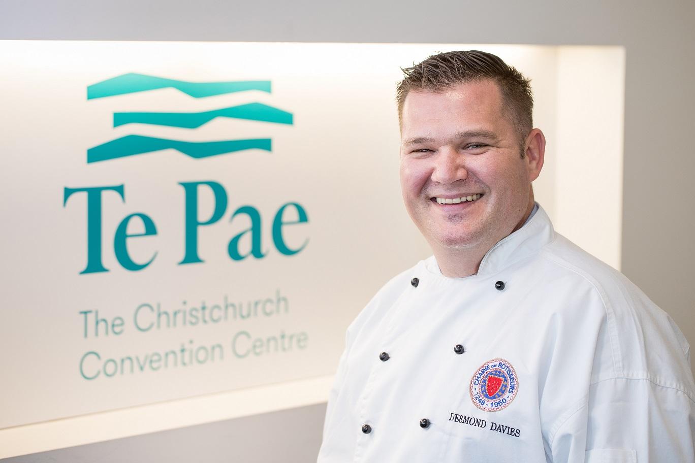 Desmond Davies infront of Te Pae Christchurch logo